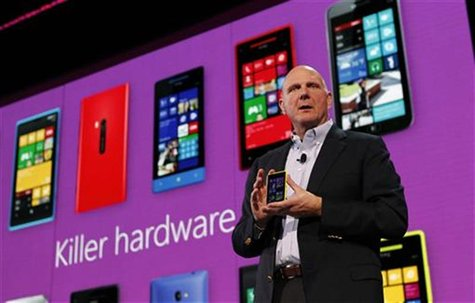 Microsoft Corp CEO Steve Ballmer displays a Nokia Lumia 920 featuring Windows Phone 8 during an event in San Francisco, California October 2