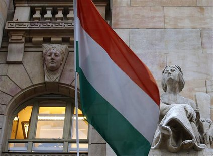 The Hungarian national flag flies on the building of the National Bank of Hungary in Budapest January 10, 2013. The bank will have a new gov