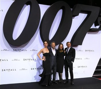 Actress Berenice Marlohe, director Sam Mendes, producer Barbara Broccoli and actor Daniel Craig (L-R) pose on the red carpet as they arrive
