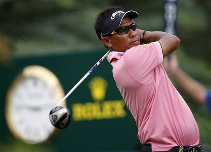 Thongchai Jaidee of Thailand watches his shot from the 16th tee during the second round of the DP World Tour Championship at Jumeirah Golf E