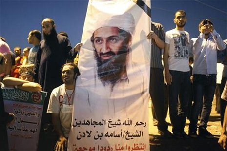 Demonstrators carry a poster of Osama Bin Laden during a protest condemning a U.S. produced movie insulting Islam's Prophet Mohammad in Tahr