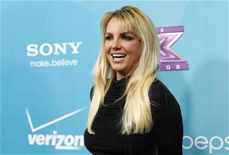 "Judge Britney Spears poses at the party for the television series ""The X Factor"" finalists in Los Angeles, California November 5, 2012. REUT"