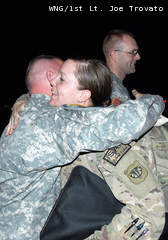 A member of the Wisconsin Army National Guard's 1157th Transportation Company is greeted upon the unit's Jan. 7, 2013 return from Afghanistan to Gulfport-Biloxi International Airport in Gulfport, Miss.