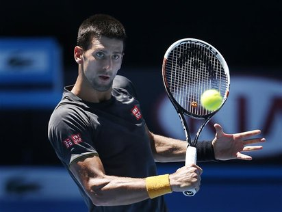 Serbia's Novak Djokovic hits the ball during a practice session at Melbourne Park January 10, 2013, ahead of the Australian Open tennis tour