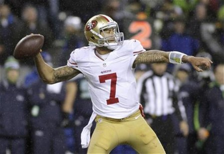 San Francisco 49ers starting quarterback Colin Kaepernick sets up to throw a pass against the Seattle Seahawks during the first quarter of t