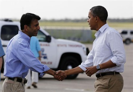 U.S. President Barack Obama shakes hands with Louisiana Governor Bobby Jindal after arriving at Louis Armstrong International Airport in New