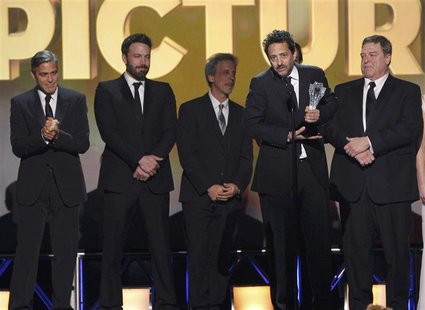 "Producer Grant Heslov accepts the award for ""Best Picture"" for ""Argo"" along with other members of the production at the 2013 Critics' Choice"
