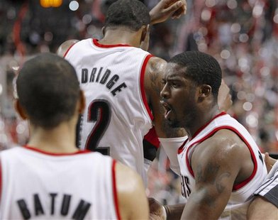 Portland Trail Blazers shooting guard Wesley Matthews (R) celebrates with teammates LaMarcus Aldridge (12) and Nicolas Batum (88) after defe