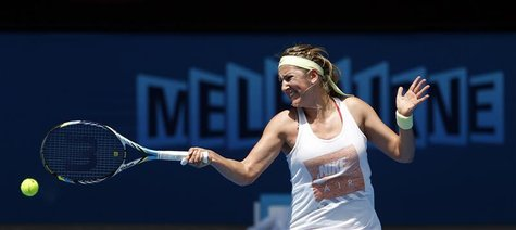 Victoria Azarenka of Belarus hits a return during a practice session at the Australian Open tennis tournament in Melbourne January 11, 2013.