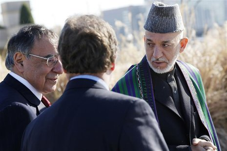 President of Afghanistan Hamid Karzai (R) walks alongside U.S. Defense Secretary Leon Panetta (L) on a guided tour of the Pentagon Memorial,