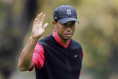Tiger Woods waves after making a birdie on the 16th hole during the final round of the World Challenge golf tournament in Thousand Oaks, Cal