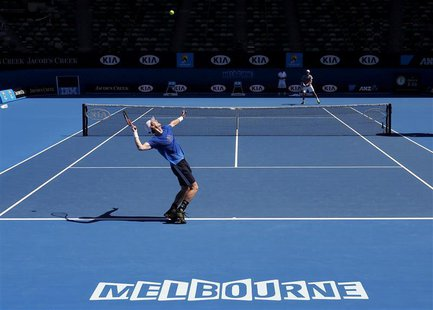 Andy Murray of Britain serves during a practice session at the Australian Open tennis tournament in Melbourne January 11, 2013. REUTERS/Tim