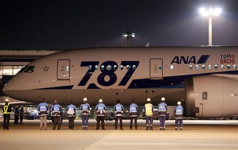 Airport staff send off All Nippon Airways' (ANA) Boeing Co's 787 Dreamliner plane before it takes off for its Tokyo-San Jose flight at New T