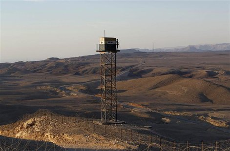 An Egyptian soldier stands guard on a watchtower on the border between Israel and Egypt, some 30 km (19 miles) north of Eilat, in this Novem
