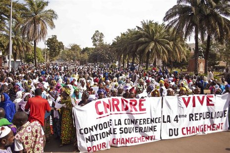 Women hold banners urging national talks to end the political paralysis in the south of Mali, in the capital Bamako January 10, 2013. Mali's