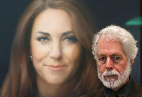 Glasgow-born artist Paul Emsley poses next to hisoil painting of Britain's Catherine, Duchess of Cambridge, the first commisioned portrait o