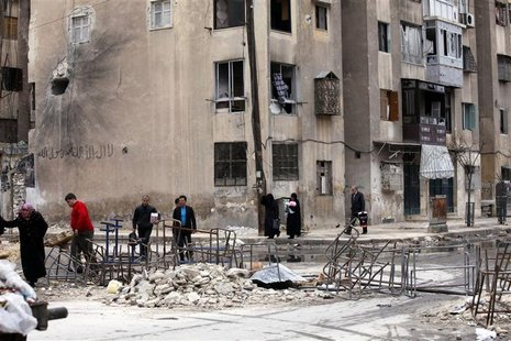 People cross the street to pass from non-liberated areas to areas controlled by the Free Syrian army in Aleppo January 8, 2013. Picture take
