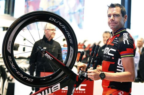 BMC Racing Team rider Cadel Evans of Australia holds his bike as he arrives at the cycling team's official presentation in Nazareth, near Gh