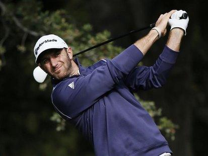 Dustin Johnson tees off on the sixth hole during the Pro-Am round of the World Challenge golf tournament in Thousand Oaks, California, Novem