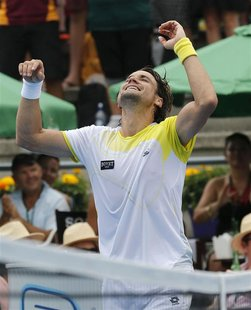 Spain's David Ferrer celebrates beating Germany's Philipp Kohlschreiber during their men's singles final match at the Heineken Open in Auckl