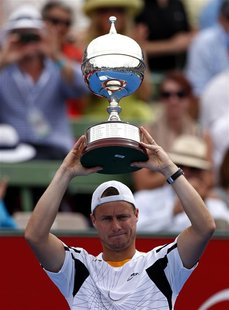 Australia's Lleyton Hewitt holds aloft the trophy after he defeated Argentina's Juan Martin Del Potro in the final at the Kooyong Classic te