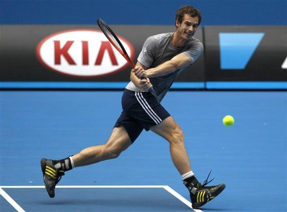 Andy Murray of Britain hits a return during a practice session at the Australian Open tennis tournament in Melbourne, January 12, 2013. REUT