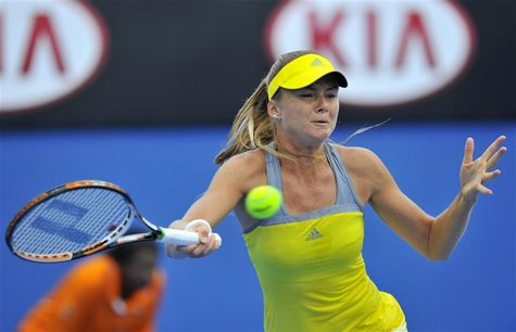 Daniela Hantuchova of Slovakia hits a return to Maria Sharapova of Russia during an exhibition match at the Australian Open tennis tournamen