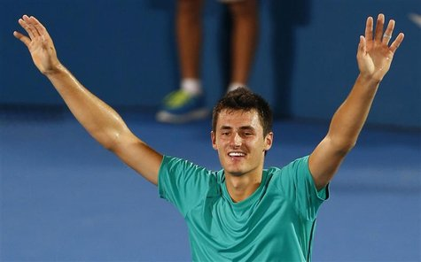 Bernard Tomic of Australia celebrates defeating Kevin Anderson of South Africa during their men's final match at the Sydney International te