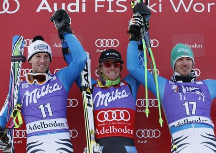 Ted Ligety of the U.S. (C) celebrates next to second-placed Fritz Dopfer of Germany (L) and third-placed Felix Neureuther of Germany on the