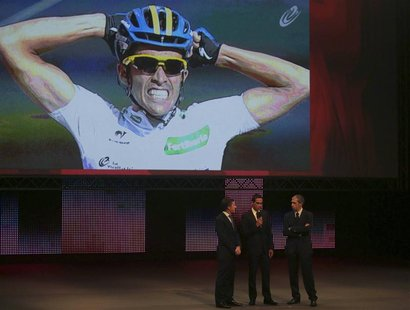 Team Saxo Bank rider and winner of the 2012 Tour of Spain, Alberto Contador (C) of Spain speaks during the 2013 Tour of Spain cycling race p