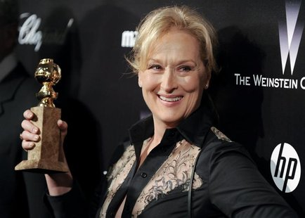 "Actress Meryl Streep shows off her Golden Globe award for the best performance by an actress in a motion picture - drama for her work in "" T"
