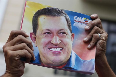 A supporter of Venezuela's President Hugo Chavez holds up a picture of him during the inauguration of the National Assembly in Caracas Janua