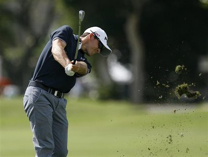 Scott Langley of the U.S. hits a fairway shot on the second hole during the third round of the Sony Open golf tournament in Honolulu, Hawaii