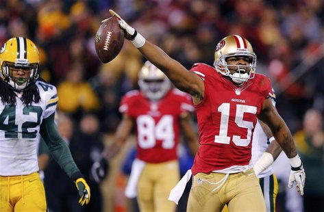 San Francisco 49ers Michael Crabtree (R) celebrate a pass reception next to Green Bay Packers Morgan Burnett (L) during the fourth quarter i