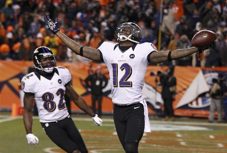 Baltimore Ravens wide receiver Jacoby Jones (R) celebrates his fourth quarter touchdown against the Denver Broncos with teammate Torrey Smit