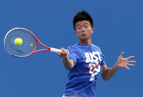 Wu Di of China serves during a practice session at the Australian Open tennis tournament in Melbourne, January 13, 2013. REUTERS/David Gray