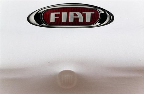 A Fiat car under covers is seen at a dealership in Rome October 30, 2012. REUTERS/Alessandro Bianchi