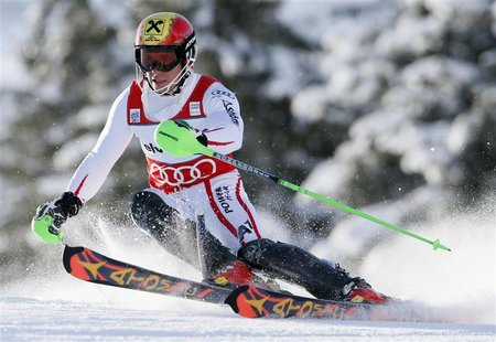 Marcel Hirscher of Austria clears a gate during the first run of the Alpine Skiing World Cup men's slalom ski race in Adelboden January 13,