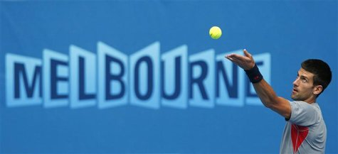 Novak Djokovic of Serbia serves during a practice session at the Australian Open tennis tournament in Melbourne January 13, 2013. REUTERS/Da