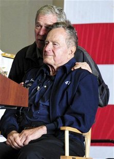 Former U.S. Presidents George W. Bush and his father George H.W. Bush attend a function onboard the USS George H.W. Bush aircraft carrier of