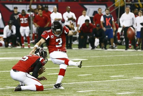 Atlanta Falcons kicker Matt Bryant (R) kicks the winning field goal with holder Matt Bosher to defeat the Seattle Seahawks in their NFL NFC