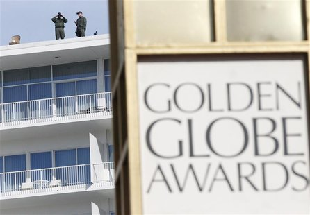 Security personnel watch from a rooftop ahead of the 70th annual Golden Globe Awards in Beverly Hills, California, January 13, 2013. REUTERS