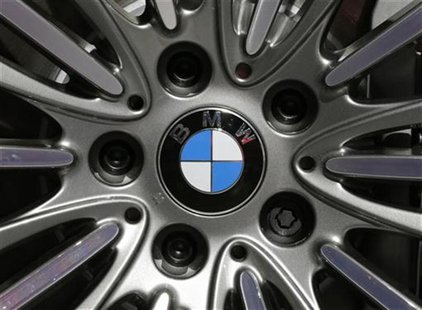 A BMW logo is seen on the rim of a BMW 650i xDrive car on media day at the Paris Mondial de l'Automobile, September 28, 2012. REUTERS/Christ