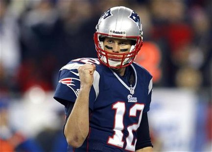 New England Patriots quarterback Tom Brady celebrates after the Patriots scored a touchdown in the third quarter of their NFL AFC Divisional