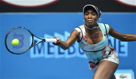 Venus Williams of the U.S. hits a return to Galina Voskoboeva of Kazakhstan during their women's singles match at the Australian Open tennis