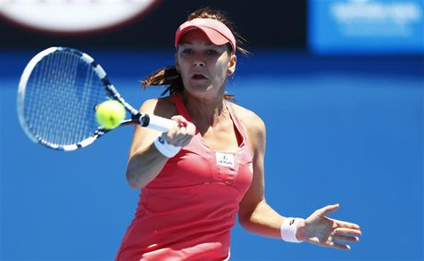 Agnieszka Radwanska of Poland hits a return to Bojana Bobusic of Australia during their women's singles match at the Australian Open tennis