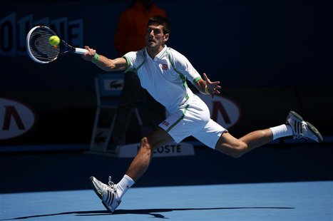 Novak Djokovic of Serbia hits a return to Paul-Henri Mathieu of France during their men's singles match at the Australian Open tennis tourna