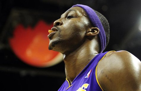 Los Angeles Lakers Dwight Howard leaves the court after being ejected for a flagrant foul on Denver Nuggets Kenneth Faried during their NBA
