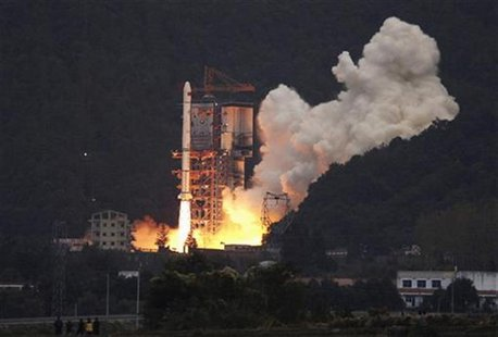 A Long March 3A rocket carrying the Chang'e One lunar orbiter blasts off from the Xichang Satellite Launch Centre in southwest China's Sichu