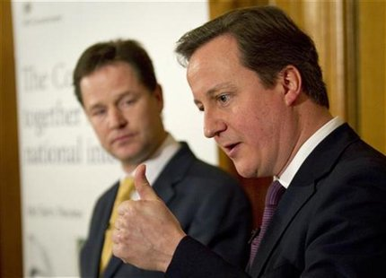Britain's Prime Minister, David Cameron (R), accompanied by Deputy Prime Minister, Nick Clegg, speaks at a news conference in 10 Downing Str